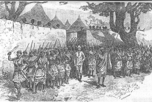 Parada zwycięstwa przed bramami miasta, na murach widoczne obcięte głowy wrogów.